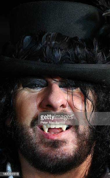 A vampire in a top hat takes part in a world record attempt at the Shocktober Fest at Tulleys Farm on October 5 2013 near Crawley West Sussex Each...