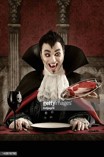 vampire ordering meat - vampire stock pictures, royalty-free photos & images