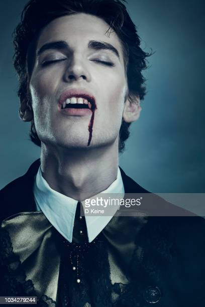 vampire - fang stock pictures, royalty-free photos & images