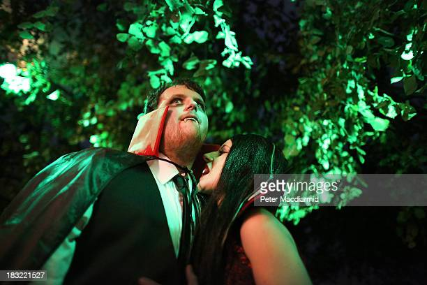 A vampire takes a bite of her mate at the Shocktober Fest at Tulleys Farm on October 5 2013 near Crawley West Sussex Each October thousands attend...