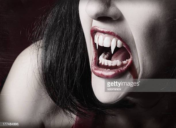 vampire teeth - fang stock pictures, royalty-free photos & images