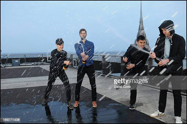 Vampire Weekend spray bottles of champagne during a video shoot on the roof of the on the MetLife Building in New York on 29th April 2013 Left to...