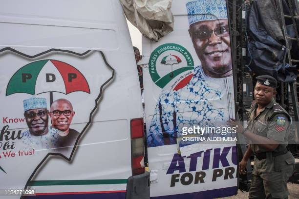 A van bearing a portrait of Atiku Abubakar the People's Democratic Party party candidate for the incoming elections in Nigeria is seen during a rally...