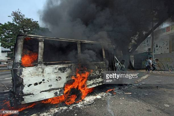 A van burns in flames during a protest against Venezuelan President Nicolas Maduro in San Cristobal Venezuela on March 17 2014 Venezuela's...