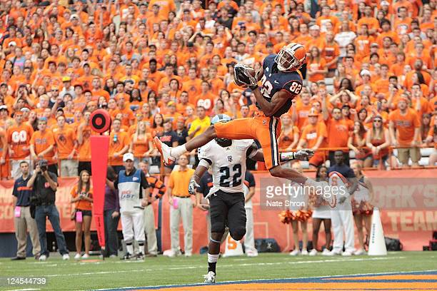 Van Chew of the Syracuse Orange catches a TD in the game against the Rhode Island Rams on September 10 2011 at the Carrier Dome in Syracuse New York