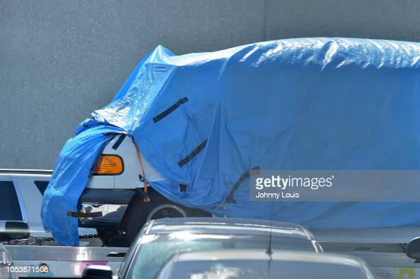 Van covered in blue tarp arrives at FBI Miramar Headquarters on October 26, 2018 in Miramar, Florida. The van belongs to Cesar Sayoc the suspect...