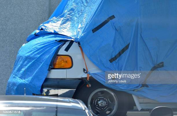 A van covered in blue tarp arrives at FBI Miramar Headquarters on October 26 2018 in Miramar Florida The van belongs to Cesar Sayoc the suspect...