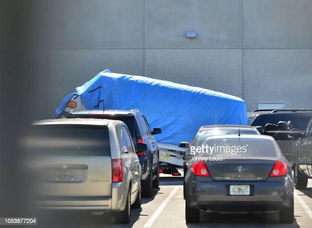 A van covered in blue tarp arrives at FBI Miramar Headquarters on October 26 2018 in Miramar Florida The van belongs to Cesar Sayoc the suspect...