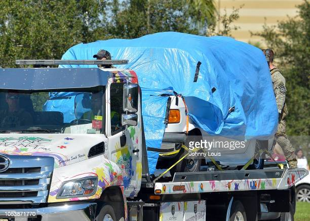 A van covered in blue tarp is towed by FBI investigators to FBI Miramar Headquarters on October 26 2018 in Miramar Florida The van belongs to Cesar...
