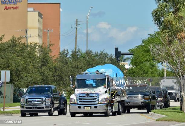 A van covered in blue tarp is towed by FBI investigators to FBI Miramar Headquarters on October 26 2018 in Miramar Florida The van belongs to Cesar...