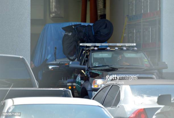 Van covered in blue tarp is unloaded by FBI investigators at FBI Miramar Headquarters on October 26, 2018 in Miramar, Florida. The van belongs to...