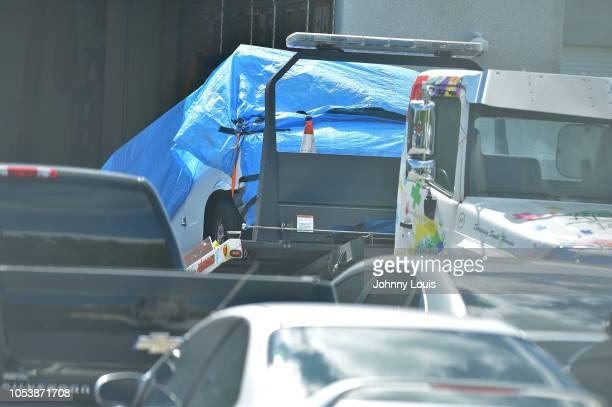 Van covered in blue tarp sits on a tow truck at FBI Miramar Headquarters on October 26, 2018 in Miramar, Florida. The van belongs to Cesar Sayoc the...