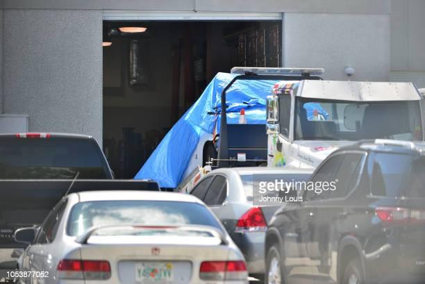 A van covered in blue tarp sits on a tow truck at FBI Miramar Headquarters on October 26 2018 in Miramar Florida The van belongs to Cesar Sayoc the...