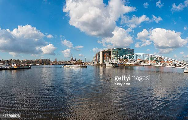 jj van de velde bridge and ij in amsterdam - nemo museum stock pictures, royalty-free photos & images