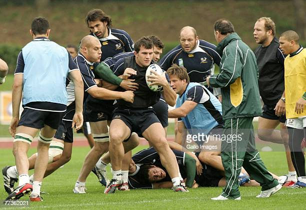 CJ van der Linde and Bismarck du Plessis of South Africa in action during the South Africa training session at the Stade Alain Mimoun on October 17...