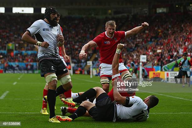 Van Der Merwe of Canada celebrates with John Moonlight after scoring the opening try during the 2015 Rugby World Cup Pool D match between Canada and...