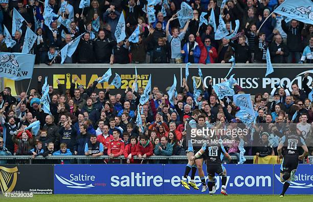 Van Der Merwe of Glasgow Warriors is congratulated by teammates after scoring his sides second try during the Guinness Pro 12 final match between...