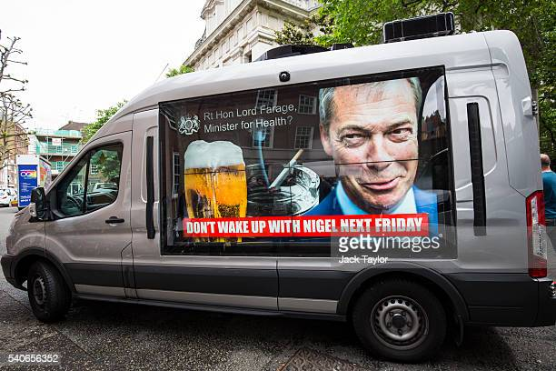 A van displaying an advert opposing United Kingdom Independence Party Leader Nigel Farage which says 'Don't Wake Up With Nigel Next Friday' is driven...
