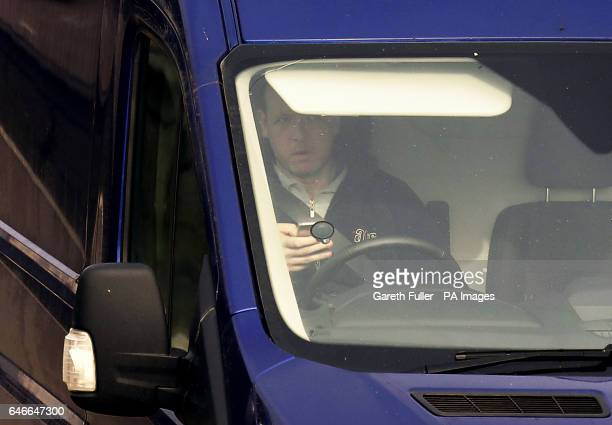 A van driver holding a mobile phone whilst driving on the M20 near Ashford Kent