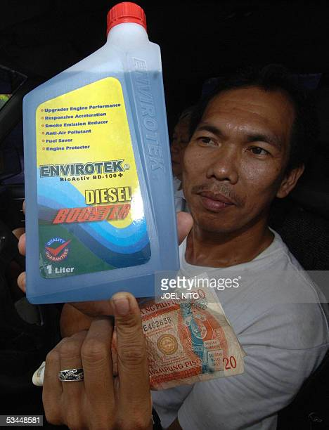 A van driver shows a special biofuel additive that is increasingly becoming popular in the Philippines as it seeks ways to conserve energy 22 August...