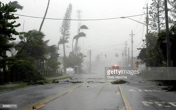 A van drives down a boulevard during Hurricane Wilma October 24 2005 in Ft Myers Florida Hurricane Wilma made landfall in the early morning hours as...