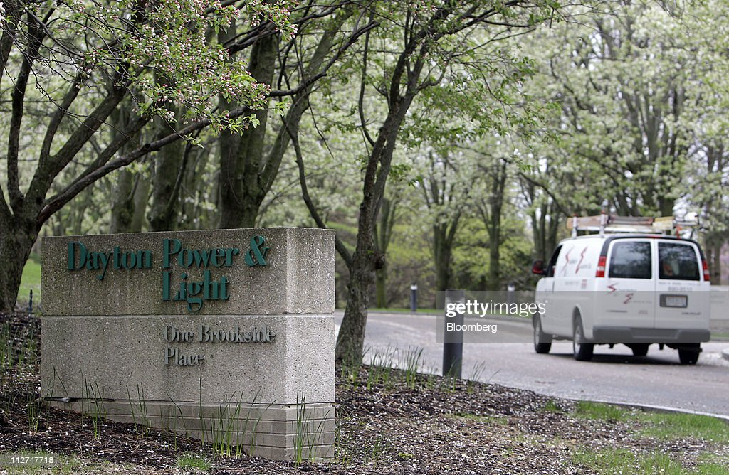 A Van Drives Past The Headquarters Of Dayton Power And Light Co., Known As