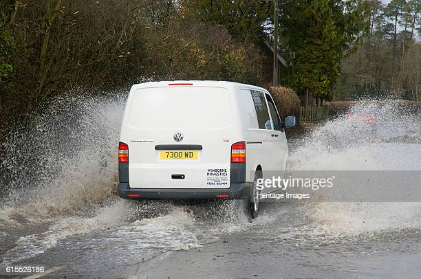 Van driving through Floods at Beauleu Hampshire 2008 Artist Unknown