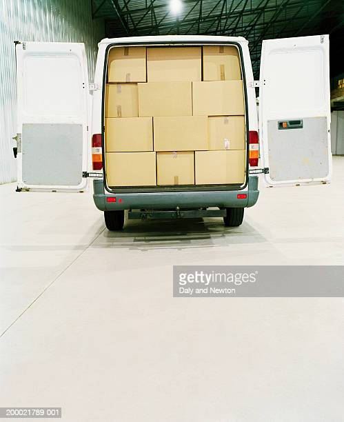 Van filled with cardboard boxes in warehouse
