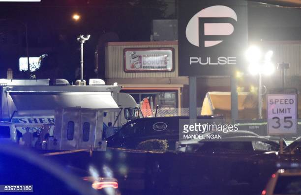 A van from a funeral service is seen infront of the Pulse club in Orlando Floridaon June 12 2016 Fifty people died when a gunman allegedly inspired...