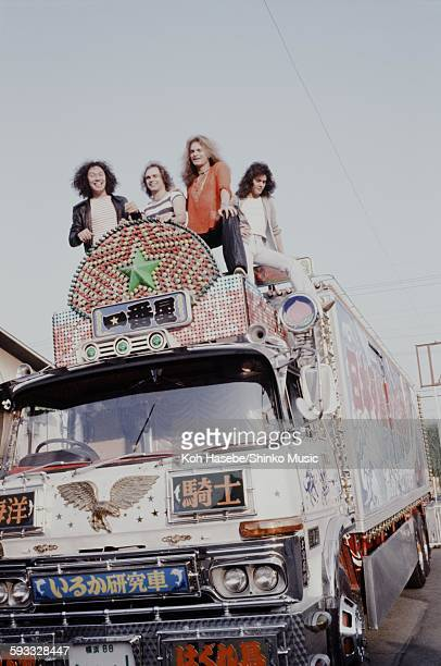 Van Halen posing on the decorated truck roof used for the movie 'Truck Yarou' in the Toei movie studio Tokyo June 1978