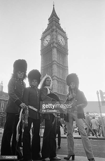 Van Halen US rock band wearing the uniforms of the King's Troop Royal Horse Artillery and holding swords as they pose near the Houses of Parliament...