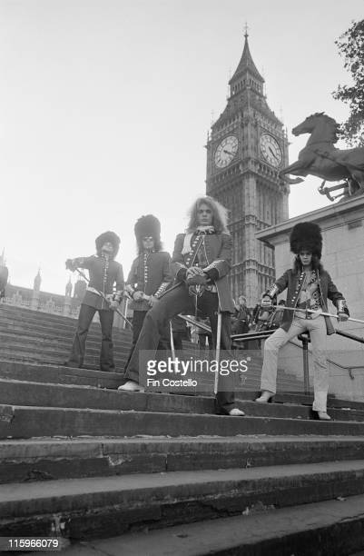 Van Halen US rock band wearing the uniforms of the King's Troop Royal Horse Artillery and holding swords as they pose on steps near the Houses of...