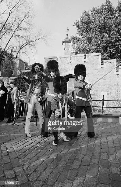 Van Halen US rock band wearing the uniforms of the King's Troop Royal Horse Artillery and holding swords as they pose near at the Tower of London...