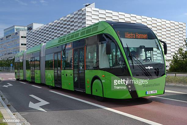 van hool exqui.city tram-bus on the road - hybrid vehicle stock photos and pictures