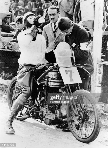 Van Horne taking a drink whilst on his Norton bike