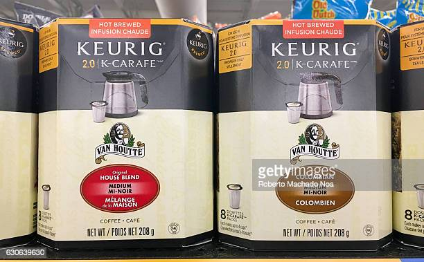 Van Houtte Colombian and House Blend coffee boxes on a supermarket shelf