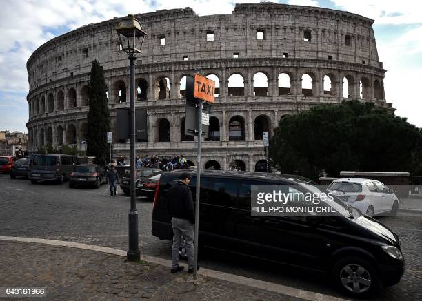 A van is parked at a Taxi station near the ancient Colosseum on February 20 2017 in Rome Taxi drivers are on strike in Rome and across Italy to...