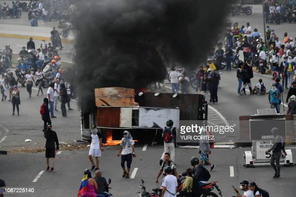 A van is set on fire by Venezuelan opposition demonstrators during a protest against the government of President Nicolas Maduro on the anniversary of...