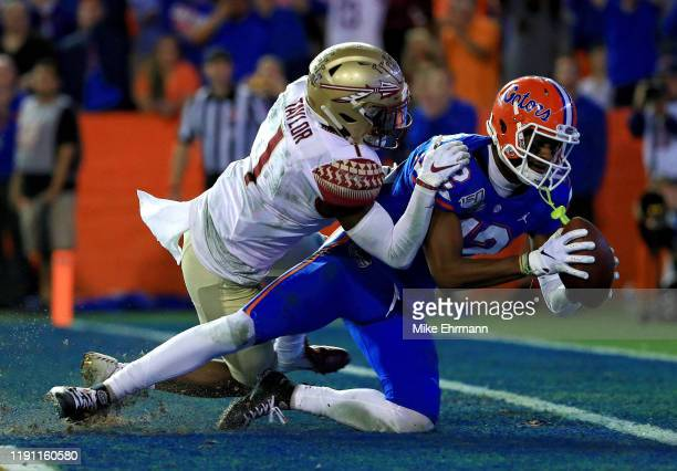 Van Jefferson of the Florida Gators scores a touchdown during a game against the Florida State Seminoles at Ben Hill Griffin Stadium on November 30...