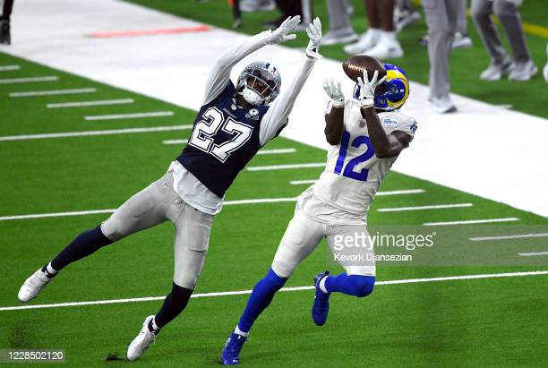 Van Jefferson of the Los Angeles Rams catches the ball against Trevon Diggs of the Dallas Cowboys during the first half at SoFi Stadium on September...