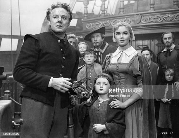 Van Johnson holding bird Noreen Corcoran found with Dawn Addams at her side in a scene from the film 'Plymouth Adventure' 1952