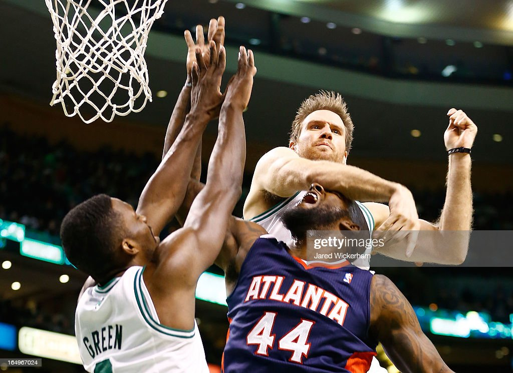 van Johnson #44 of the Atlanta Hawks gets hit in the head by Shavlik Randolph #42 of the Boston Celtics during the game on March 29, 2013 at TD Garden in Boston, Massachusetts.