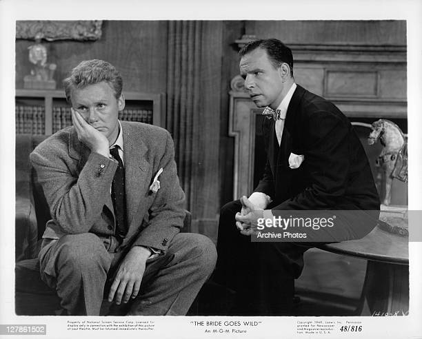 Van Johnson with hand to face while Hume Cronyn watches in a scene from the film 'The Bride Goes Wild', 1948.