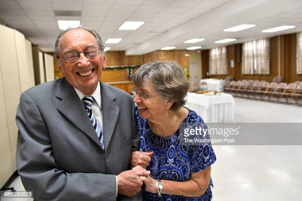 Van Knauss and Patricia Lawson who have known each other for decades share a laugh after service and before the start of a party in the social hall...