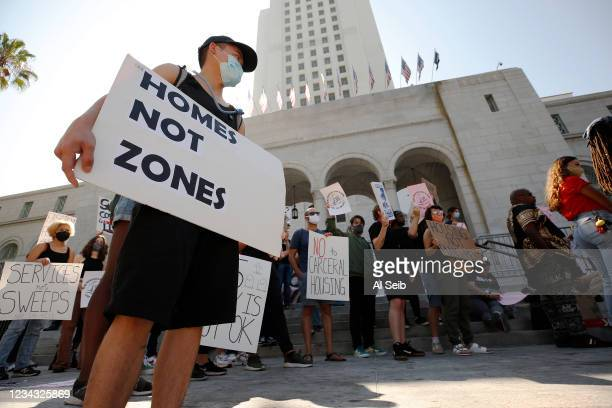 Van, left, joins people gathered for The Right to REST without ARREST Rally and Press Conference on the steps of Los Angeles City Hall Wednesday...