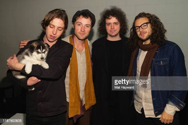 Van McAnn, Johnny Bond, Benji Blakeway and Bob Hall of Catfish and the Bottlemen pose for a photo backstage durign Deck The Hall Ball hosted by 107.7...