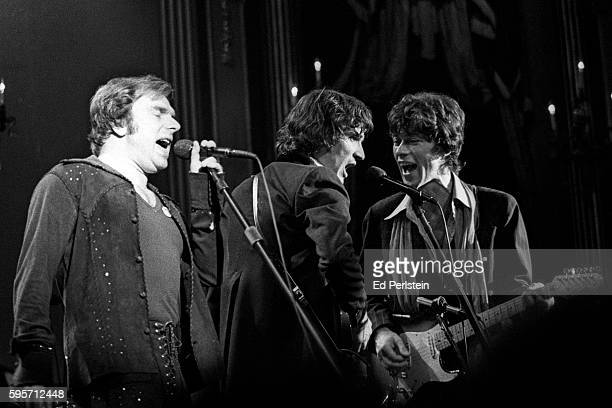 Van Morrison with Rick Danko and Robbie Robertson of The Band performs during The Last Waltz at Winterland on November 25 1976 in San Francisco...