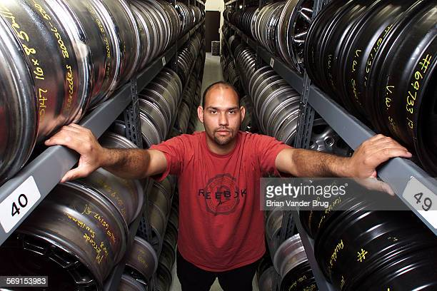 Van Nuys Hub Caps and Wheels store manager Robert Lopez inside the Van Nuys Blvd store warehouse containing over 10000 hub caps and wheels