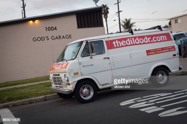 A van of the Dildo Doctor parked in front of god's garage across the Christ Evangelical Lutheran Church