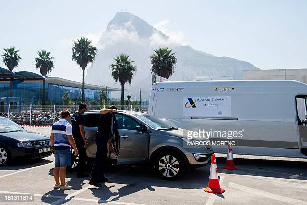 A van of the Spanish customs equipped with a Mobile XRay Scanner passes next to cars parked at the border between Spain and Gibraltar as customs...